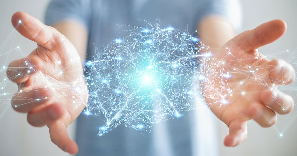 Neurocentric Coaching Illustration Of Hands With Hologram COnnections Between Them That Form A Brain